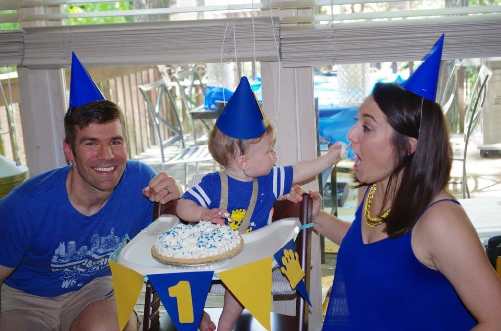 Family with Tippin's pie for 1st Birthday