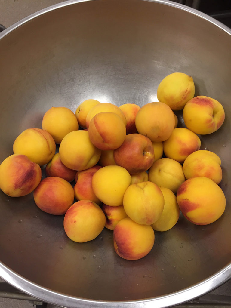 Bowl of fresh peaches